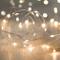 Lights4fun - Filo di 50 Micro LED Bianco Caldo a Pile su Cavo Metallico Argento